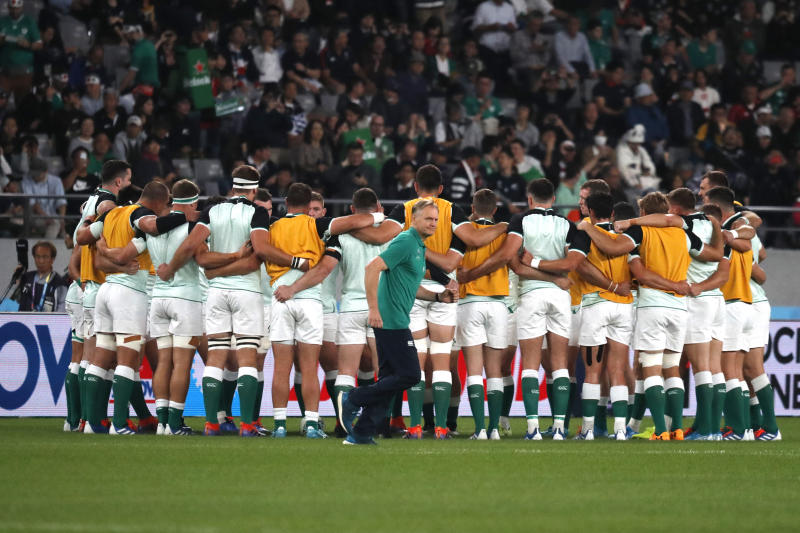 Ireland coach Joe Schmidt moves past his players ahead of the Rugby World Cup quarterfinal match at Tokyo Stadium between New Zealand and Ireland in Tokyo, Japan, Saturday, Oct. 19, 2019. (AP Photo/Eugene Hoshiko)