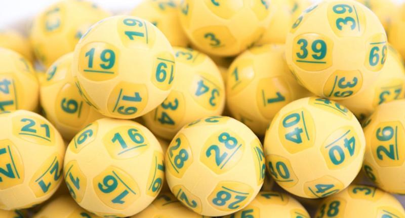 Oz Lotto playing balls pictured as officials call on the NSW $50 million jackpot winner to come forward.