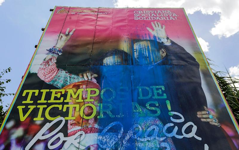 A vandalized billboard supporting Nicaragua's President Daniel Ortega and his wife and Vice President Rosario Murillo, who a student leader says are now despised by the people (AFP Photo/INTI OCON)