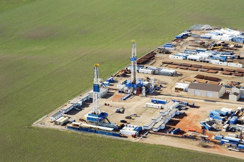 Stacked rigs and other idle oil equipment is seen in a Nabors Drilling yard near Williston