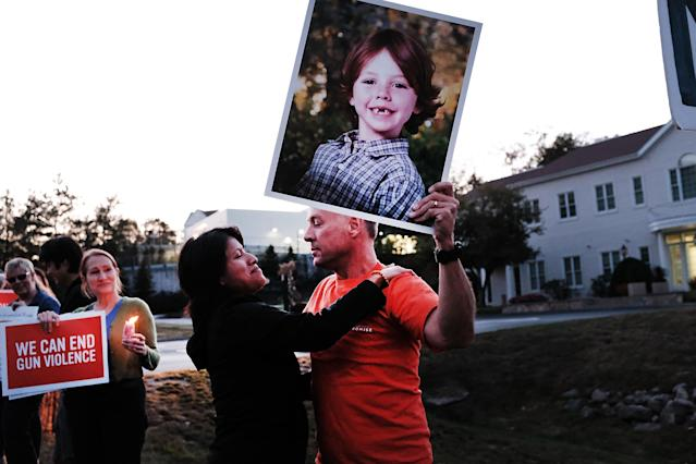 In a protest on Oct. 4 in Newtown, Conn., responding to the Las Vegas shooting and calling for tighter gun control, Mark Barden holds up a picture of his son, Daniel, who was killed in the massacre at the Sandy Hook Elementary School in 2012. (Photo: Spencer Platt/Getty Images)