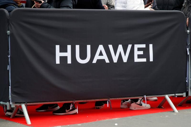 Must finish work on impact of U.S. sanctions before any Huawei update, says UK PM's spokesman