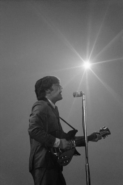 This Feb. 11, 1964 image provided by the David Anthony Fine Art gallery in Taos, N.M., shows a photograph of John Lennon taken by photographer Mike Mitchell during the Beatles first live U.S. concert at the Washington Coliseum. Mitchell's portraits of the Beatles are the centerpiece of a monthlong photography exhibition at the gallery. This marks the first time the images have been shown since their unveiling in 2011 at a Christie's auction in New York City. (AP Photo/David Anthony Fine Art, Mike Mitchell)