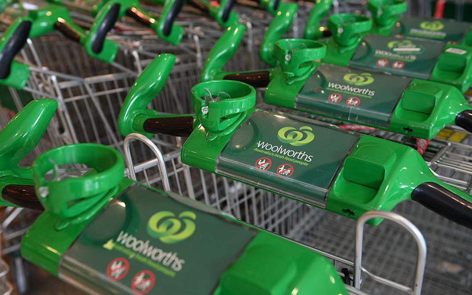 Woolworths shopping carts are seen at a store in Sydney.