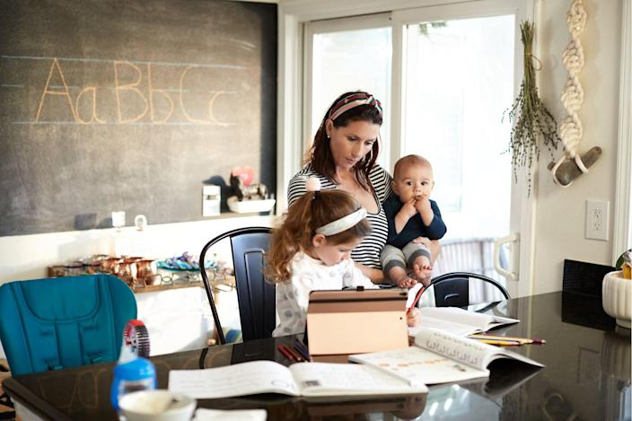 A young mother helps her kids learn remotely in a beautifully renovated home classroom.