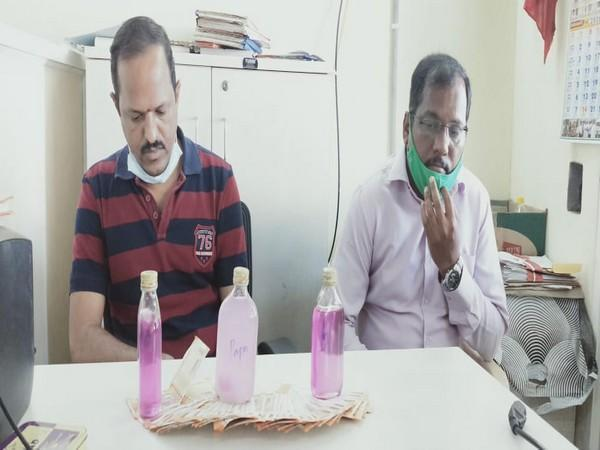 The arrested officials of the power distribution company in Telangana.