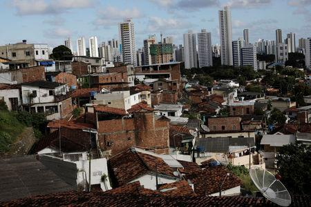 Houses stand in the Morro da Conceicao neighbourhood in front of high rises in Recife, Brazil, August 10, 2018. REUTERS/Ueslei Marcelino/Files
