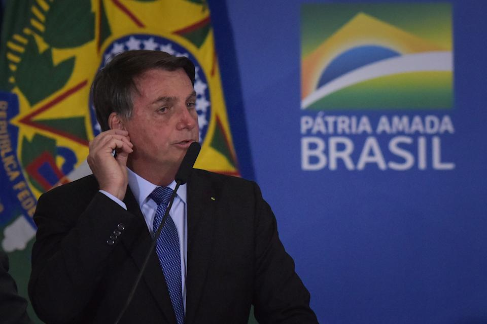 Brazil's President Jair Bolsonaro speaks during the Emergency Aid Extension ceremony at the Planalto Palace in Brasília, Brazil, on June 30, 2020. The Emergency Aid is a financial benefit granted by the Federal Government to workers and unemployed people affected by the Coronavirus (COVID-19) pandemic. (Photo by Andre Borges/NurPhoto via Getty Images)