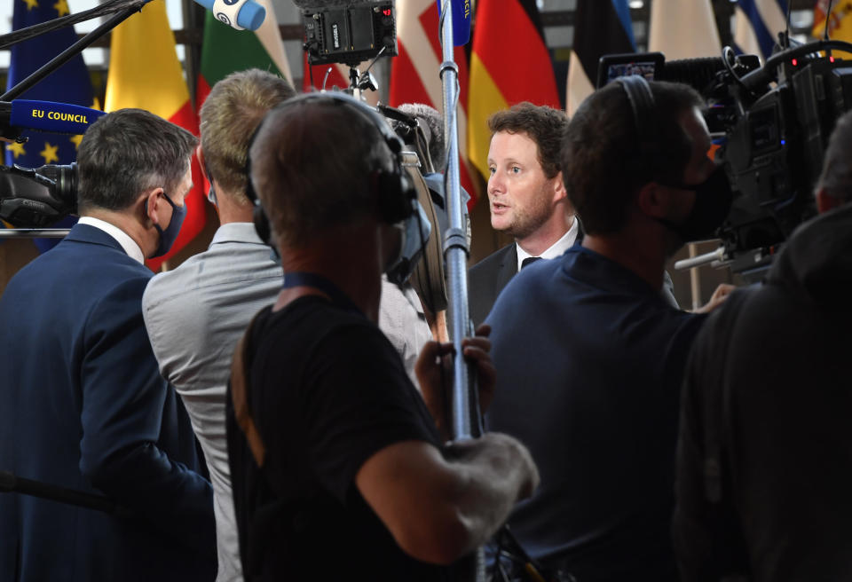 France's European Affairs Minister Clement Beune, right, speaks with the media as he arrives for a meeting of EU General Affairs ministers at the European Council building in Brussels, Tuesday, Sept. 21, 2021. European Union General Affairs ministers meet Tuesday to discuss the state of play in UK-EU relations and a submarine deal between the U.S., Britain and Australia, which led to France losing a contract to sell subs to Australia. (AP Photo/Geert Vanden Wijngaert)