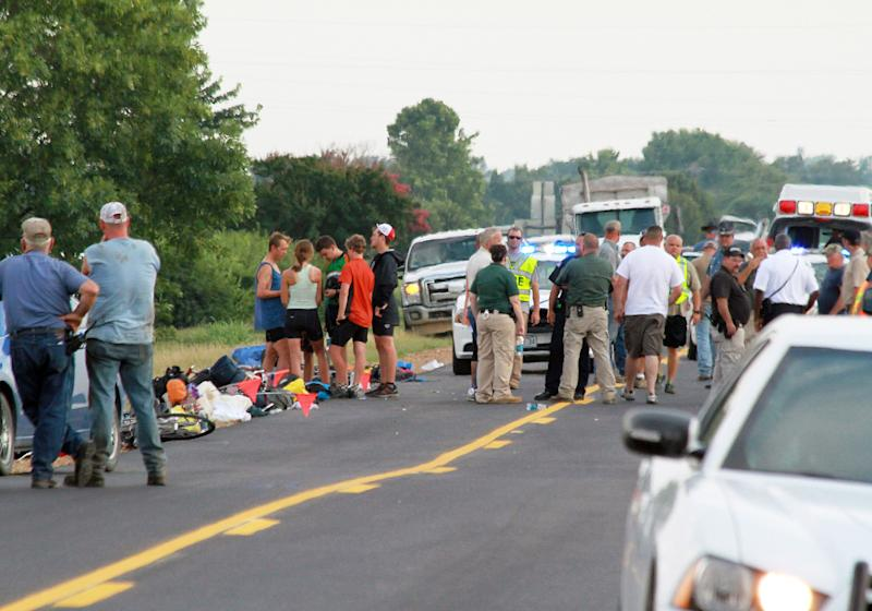 FILE - This July 2, 2013 file photo provided by Walter Breckenridge shows the scene of an accident in McCrory, Ark., after a car crashed into a group of bicyclists from a Massachusetts-based summer camp program on a cross-country trip, according to authorities. Police say, on Thursday, July 4, 2013, that an 18-year-old Massachusetts woman has died after she was injured in the accident. (AP Photo/Walter Breckenridge, File) MANDATORY CREDIT