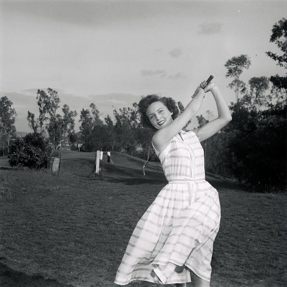 <p>White swings a golf club while on location for <em>Date with the Angels </em>in Los Angeles, California. The sitcom only lasted for 33 episodes, ending in 1958. In total, she has acted as a lead or recurring character on roughly 25 different television series. This, of course, is not counting the numerous programs where she served as host.</p>