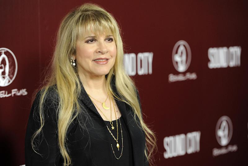 "FILE - This Jan. 31, 2013 file photo shows singer Stevie Nicks at the premiere of the documentary film ""Sound City"" in Los Angeles. The singer will guest star on an upcoming episode of the FX series. Creator Ryan Murphy revealed the guest spot news Tuesday, Nov. 12, over his official Twitter account. (Photo by Chris Pizzello/Invision/AP, File)"