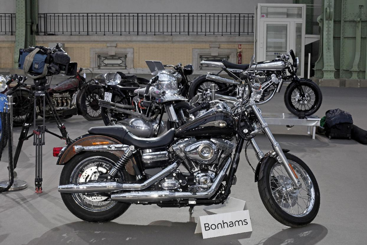 The 2013 Harley DavidsonSuper Glide Custom A 1,585cc Harley-Davidson Dyna Super Glide, donated to Pope Francis last year and signed by him on its tank, is displayed ahead of Bonham's sale of vintage and classic cars, at the Grand Palais in Paris, Wednesday, Feb. 5, 2014. The bike will be sold at auction to help raise funds for a soup kitchen and hostel for the homeless in Rome. (AP Photo/Thibault Camus)