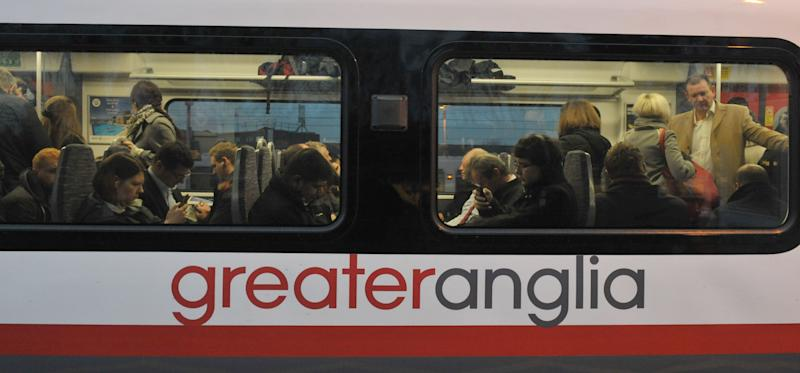 Commuters on board a Greater Anglia train at Shenfield in Essex, as workers in five rail companies stage a fresh wave of strikes in the bitter disputes over the role of guards, causing disruption to services in the first full week back to work after the festive break.
