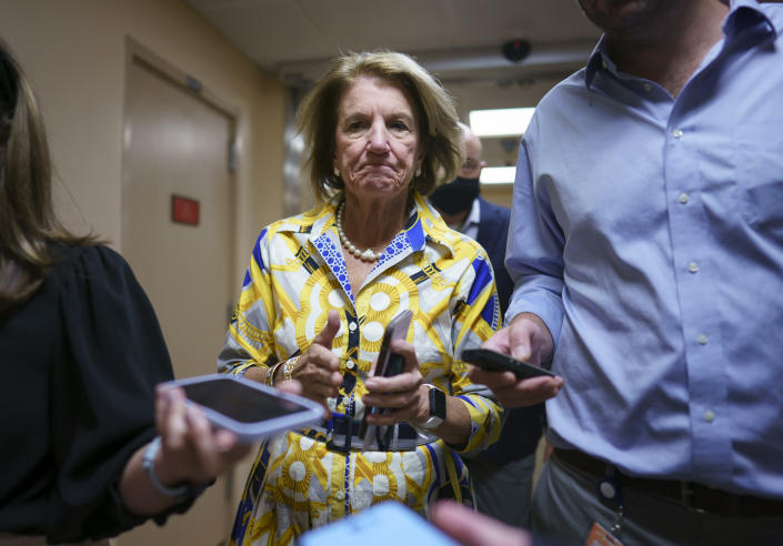 Sen. Shelley Moore Capito, R-W.Va., speaks to reporters as intense negotiations continue to salvage a bipartisan infrastructure deal, at the Capitol in Washington, Tuesday, July 27, 2021. (AP Photo/J. Scott Applewhite)