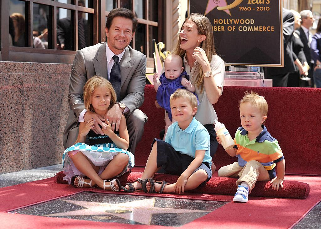 "Mark Wahlberg, who was the youngest of nine children growing up in Boston, has always said he wants nine kids of his own – and he seems to be on his way! The ""Ted"" actor and his wife, former model Rhea Durham, are the proud parents of four little ones: Ella, 9, Michael, 6, Brendan, nearly 4, and Grace, 2. ""[Having a full house] is awesome,"" he has said. ""Hectic at times, but a lot of fun."""