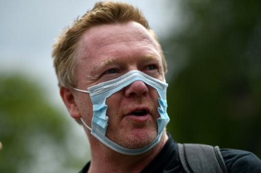 The unmasked man: One of the participants of an anti-mask protest in London