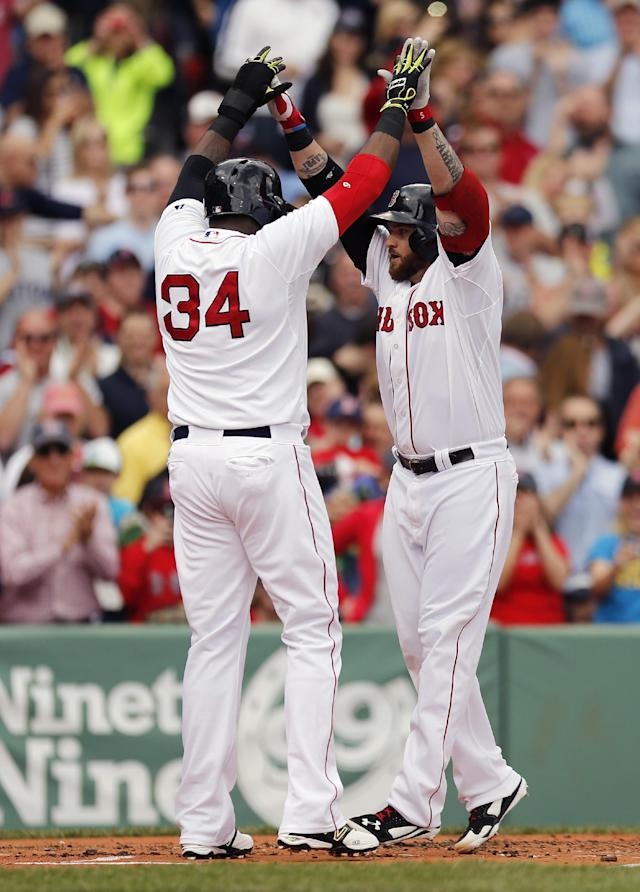 Boston Red Sox's Jonny Gomes, right, celebrates his grand slam with David Ortiz (34) in the first inning of a baseball game against the Oakland Athletics in Boston, Saturday, May 3, 2014. (AP Photo/Michael Dwyer)