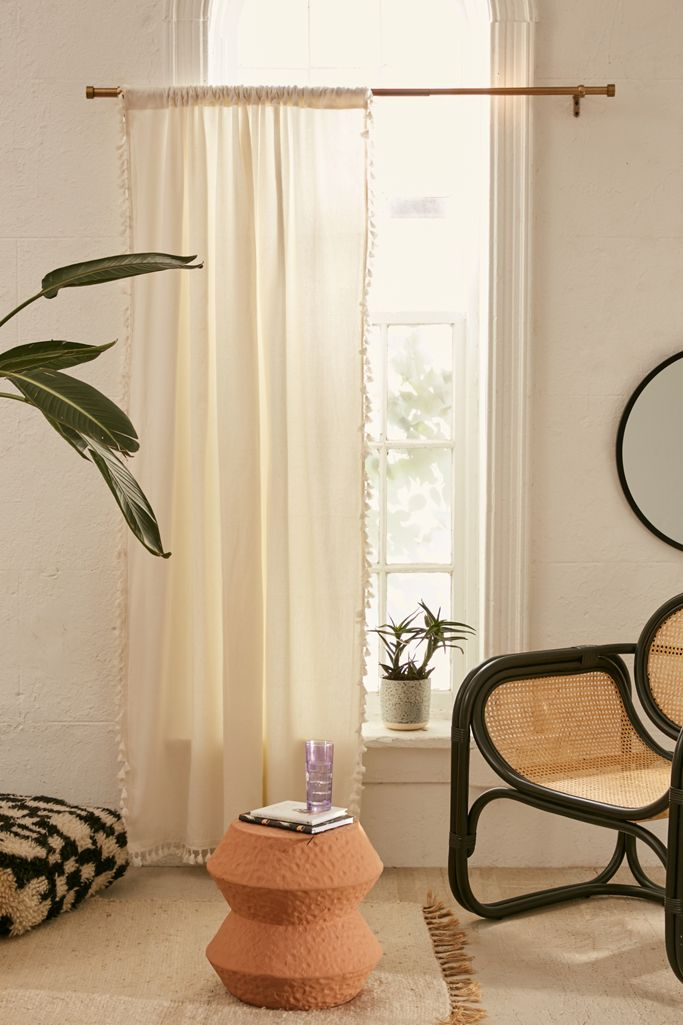 """<h3><a href=""""https://www.urbanoutfitters.com/shop/palma-fringe-light-blocking-window-curtain"""" rel=""""nofollow noopener"""" target=""""_blank"""" data-ylk=""""slk:Palma Fringe Light Blocking Window Curtain"""" class=""""link rapid-noclick-resp"""">Palma Fringe Light Blocking Window Curtain</a></h3><br>Blackout curtains are a dream come true when you want to sleep until noon but aren't exactly conducive to waking up bright and early. A gauzy curtain in a peachy pink or bronze shade will gently let light in without feeling like you're being attacked by the sun, and as a bonus looks absolutely adorable.<br><br><strong>Urban Outfitters</strong> Palma Fringe Light Blocking Window Curtain, $, available at <a href=""""https://go.skimresources.com/?id=30283X879131&url=https%3A%2F%2Fwww.urbanoutfitters.com%2Fshop%2Fpalma-fringe-light-blocking-window-curtain"""" rel=""""nofollow noopener"""" target=""""_blank"""" data-ylk=""""slk:Urban Outfitters"""" class=""""link rapid-noclick-resp"""">Urban Outfitters</a>"""