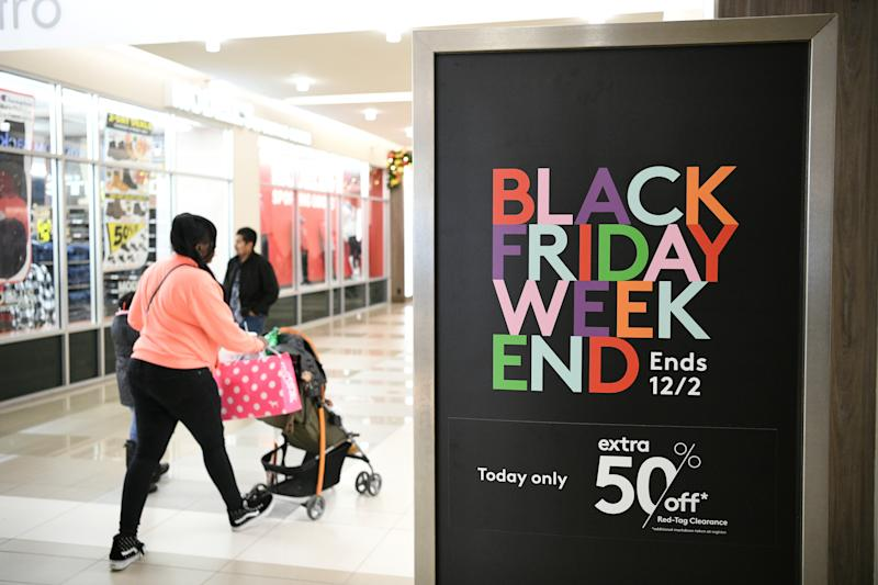 Holiday shoppers look for deals during the Black Friday sales event at the Pentagon Centre shopping mall in Arlington, Virginia, U.S., November 29, 2019. REUTERS/Loren Elliott