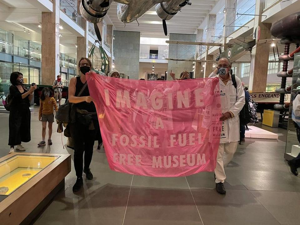 A protest inside the Science Museum in London (Isobel Frodsham/PA) (PA Wire)
