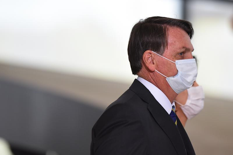 Brazil's president Jair Bolsonaro arrives to attend the launching ceremony of a campaign to support rural women at Palace in Brasilia, Brazil, on Wednesday, July 29, 2020. (Photo by Andre Borges/NurPhoto via Getty Images)