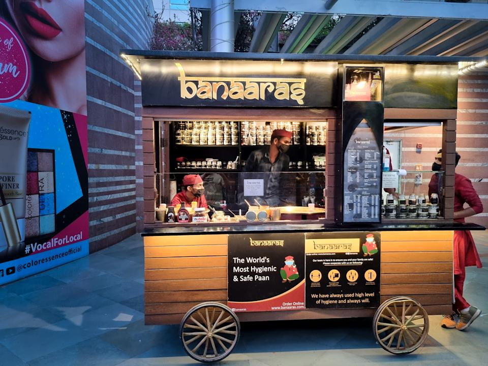 gurgaon, delhi, india - circa 2021 : banaaras paan stall serving royal beetle leaf as a dessert or a traditional after dinner mint snack in India showing pop up stalls of new companies popping up
