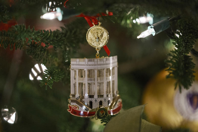 """The Official 2018 White House Christmas Ornament is seen during the 2018 Christmas Press Preview at the White House in Washington, Monday, Nov. 26, 2018. Christmas has arrived at the White House. First lady Melania Trump unveiled the 2018 White House holiday decor on Monday. She designed the decor, which features a theme of """"American Treasures."""" (AP Photo/Carolyn Kaster)"""