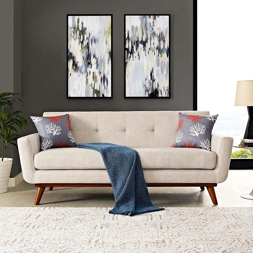 <p>The mi-century modern design of this <span>Modway Engage Upholstered Fabric Loveseat</span> ($784) sold us.</p>