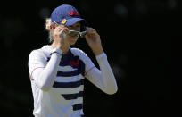 Nelly Korda, of the United States, sets her sunglasses on the 17th hole during the second round of the women's golf event at the 2020 Summer Olympics, Thursday, Aug. 5, 2021, at the Kasumigaseki Country Club in Kawagoe, Japan. (AP Photo/Andy Wong)