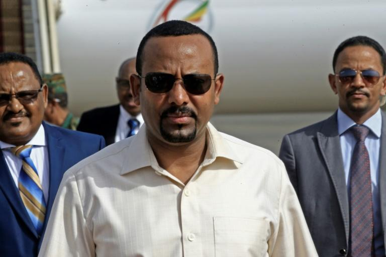 Ethiopia's Prime Minister Abiy Ahmed (C) has denounced attacks on mosques (AFP Photo/ASHRAF SHAZLY)