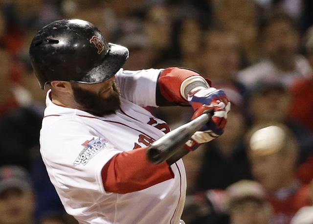 Boston Red Sox's Dustin Pedroia hits a single during the first inning of Game 1 of baseball's World Series against the St. Louis Cardinals Wednesday, Oct. 23, 2013, in Boston. (AP Photo/David J. Phillip)