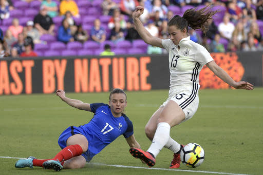 France's Marion Torrent (17) blocks a kick by Germany's Sara Daebritz (13) in front of the net during the second half of a SheBelieves Cup women's soccer match Wednesday, March 7, 2018, in Orlando, Fla. France won 3-0. (AP Photo/Phelan M. Ebenhack)