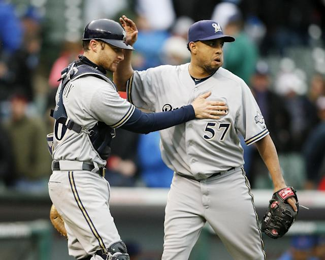 Milwaukee Brewers catcher Jonathan Lucroy, left, and relief pitcher Francisco Rodriguez, right, celebrate their victory against the Chicago Cubs in a baseball game on Friday, May 16, 2014, in Chicago. (AP Photo/Andrew A. Nelles)