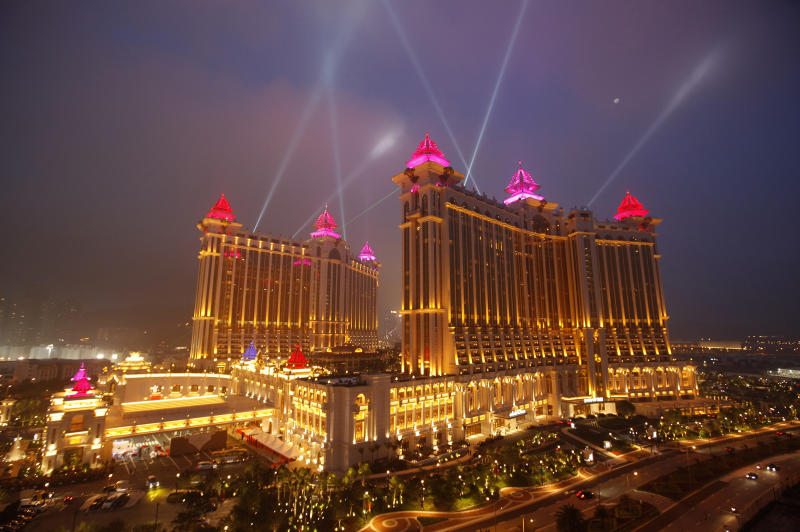 FILE - In this May 15, 2011 file photo, the complex of Galaxy Macau is illuminated in Macau. In the Philippines, a $4-billion casino project will soon rise from reclaimed land on Manila Bay. In South Korea, foreign investors are scheduled to break ground next year on a clutch of casino resorts offshore. The projects are part of a casino building boom rolling across Asia, where governments are trying to develop their tourism markets to capture increasingly affluent Asians with a penchant for gambling. (AP Photo/Vincent Yu, File)
