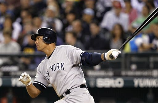 New York Yankees' Alex Rodriguez hits a home run against the Seattle Mariners in the eighth inning of a baseball game Monday, July 23, 2012, in Seattle. (AP Photo/Elaine Thompson)