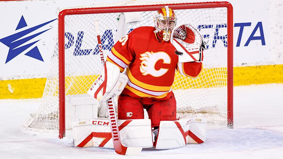 CALGARY, AB - APRIL 04: Calgary Flames Goalie David Rittich (33) catches the puck during the first period of an NHL game where the Calgary Flames hosted the Toronto Maple Leafs on April 4, 2021, at the Scotiabank Saddledome in Calgary, AB. (Photo by Brett Holmes/Icon Sportswire via Getty Images)