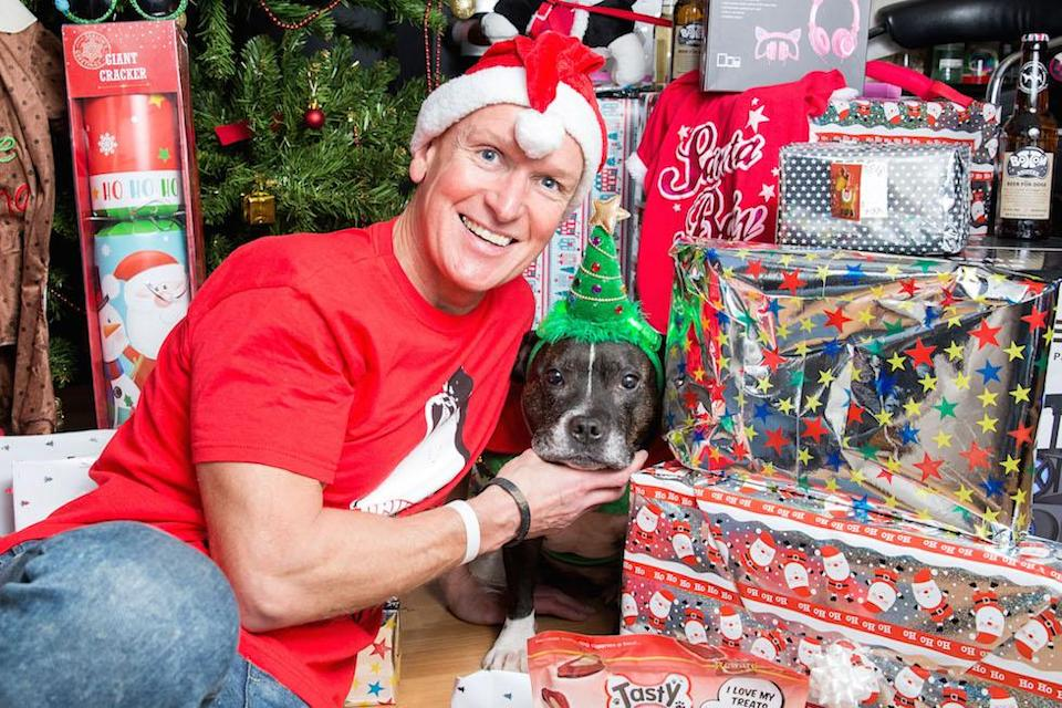 Anthony Welsh and the presents for his dog, Princess Cleopatra Superchill (Picture: Caters)