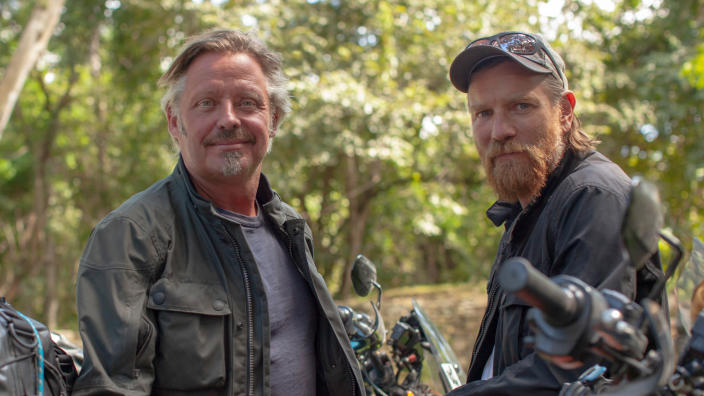 Charley Boorman and Ewan McGregor in travel documentary series 'Long Way Up'. (Credit: Apple TV+)