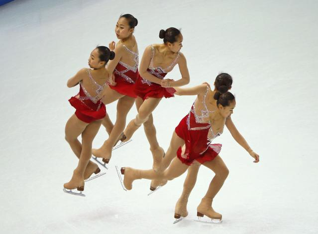 Zhang Kexin of China competes during the figure skating team ladies short program at the Sochi 2014 Winter Olympics, February 8, 2014. Picture taken with multiple exposure. REUTERS/Brian Snyder (RUSSIA - Tags: SPORT FIGURE SKATING OLYMPICS TPX IMAGES OF THE DAY)