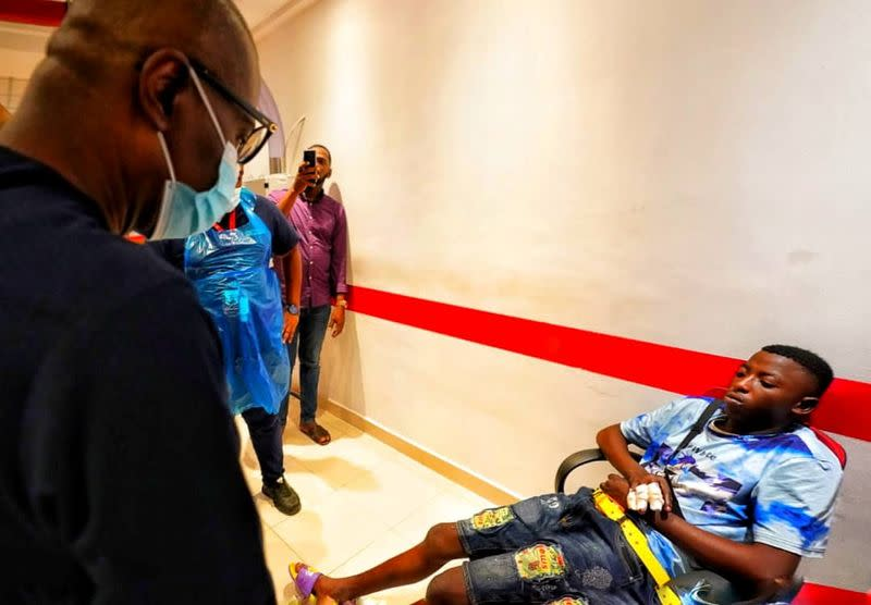 Lagos State Goveror Babajide Sanwo-Olu visits injured people at a hospital in Lagos