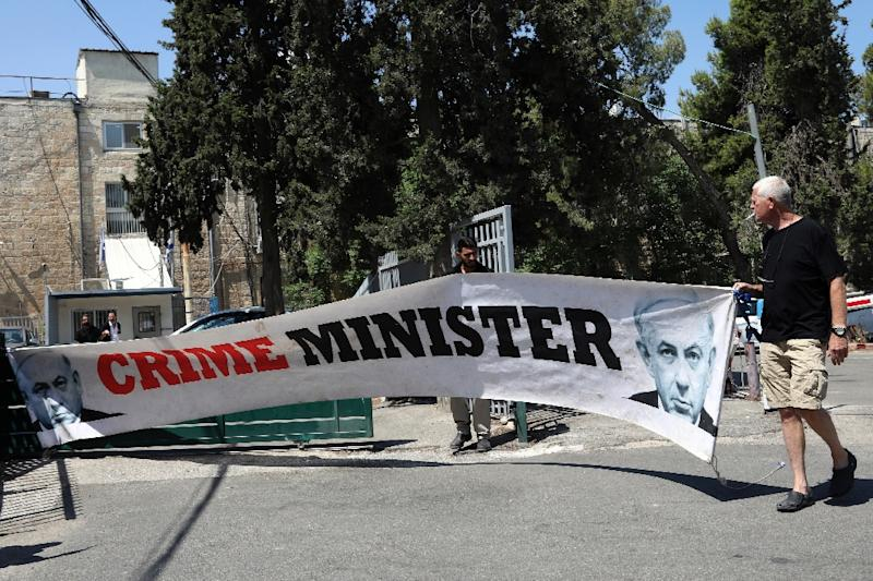 Israelis have organised repeated protests against Prime Minister Benjamin Netanyahu, who also faces potential indictment in graft cases (AFP Photo/GALI TIBBON)