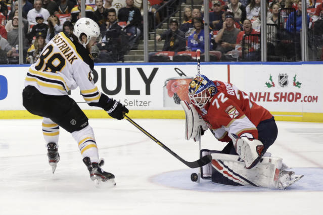 Florida Panthers goaltender Sergei Bobrovsky (72) stops a shot by Boston Bruins right wing David Pastrnak (88) during the third period of an NHL hockey game, Saturday, Dec. 14, 2019, in Sunrise, Fla. The Bruins won 4-2. (AP Photo/Lynne Sladky)