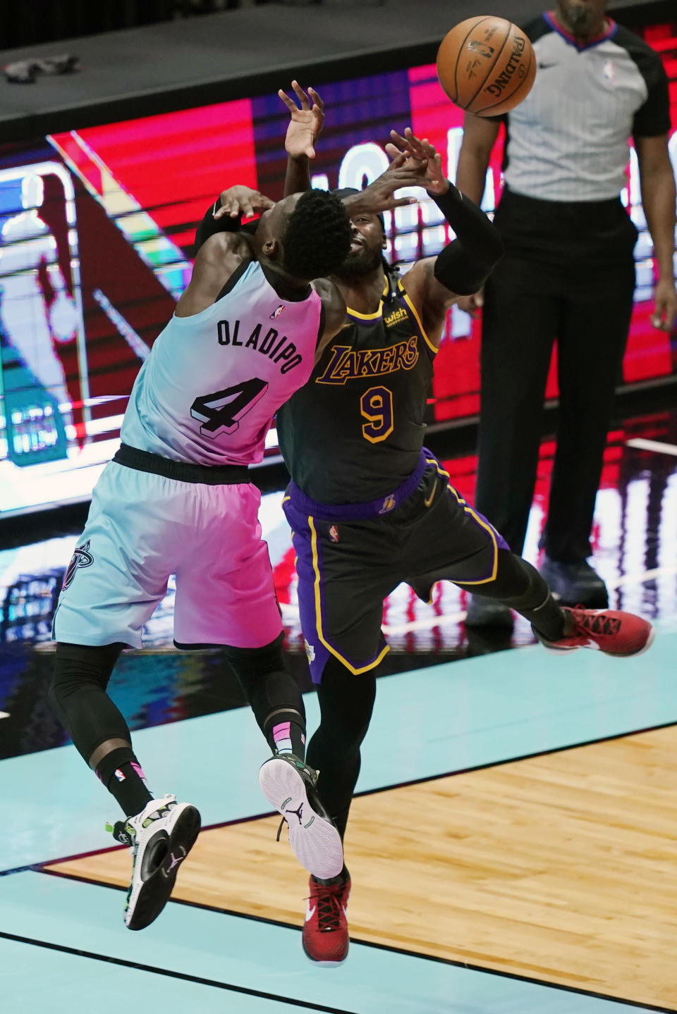 Los Angeles Lakers guard Wesley Matthews (9) fouls Miami Heat guard Victor Oladipo (4) during the first half of an NBA basketball game, Thursday, April 8, 2021, in Miami. (AP Photo/Marta Lavandier)