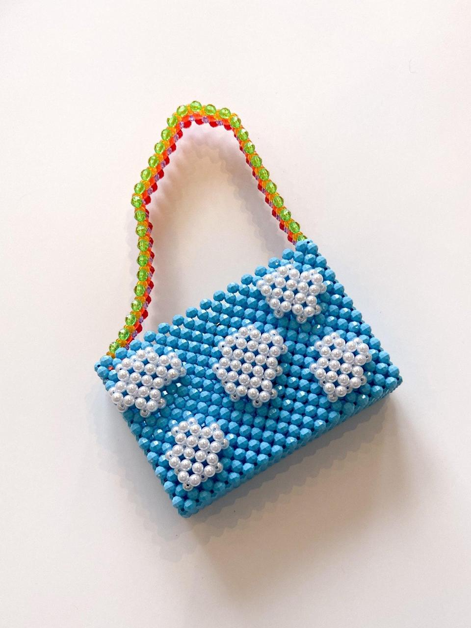 <p>Get playful and treat yourself to this <span>Lisa Says Gah Mini Cloud Bag</span> ($236, originally $295) - the shoulder strap is a rainbow!</p>