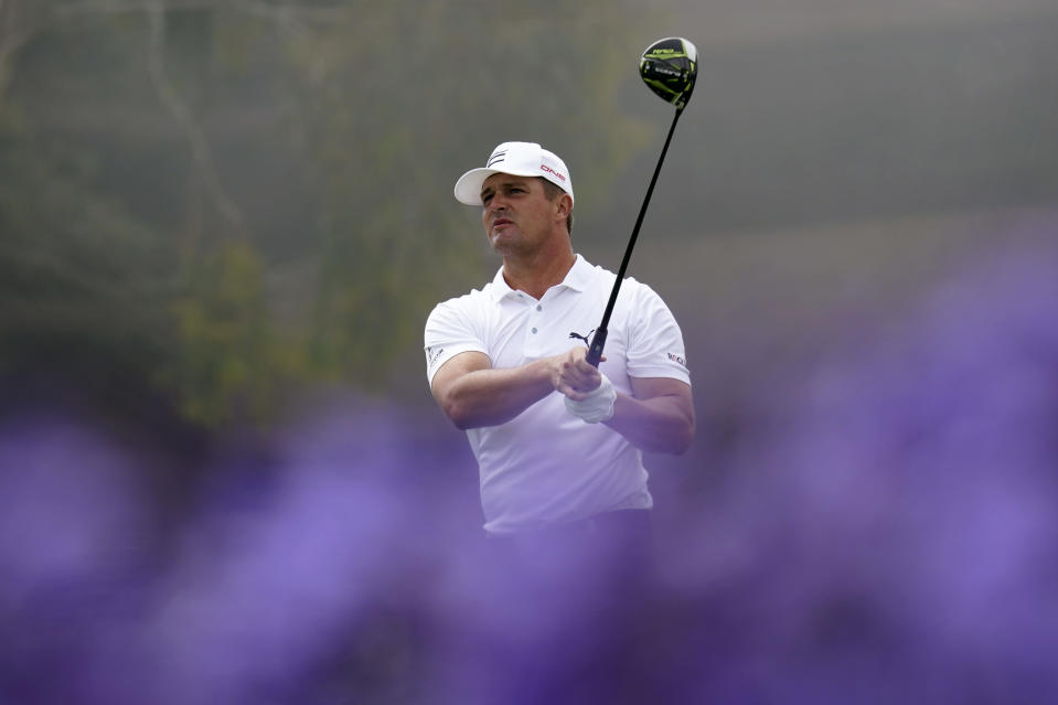 Bryson DeChambeau watches his tee shot on the 14th hole during a practice round for the U.S. Open Golf Championship Monday, June 14, 2021, at Torrey Pines Golf Course in San Diego. (AP Photo/Gregory Bull)