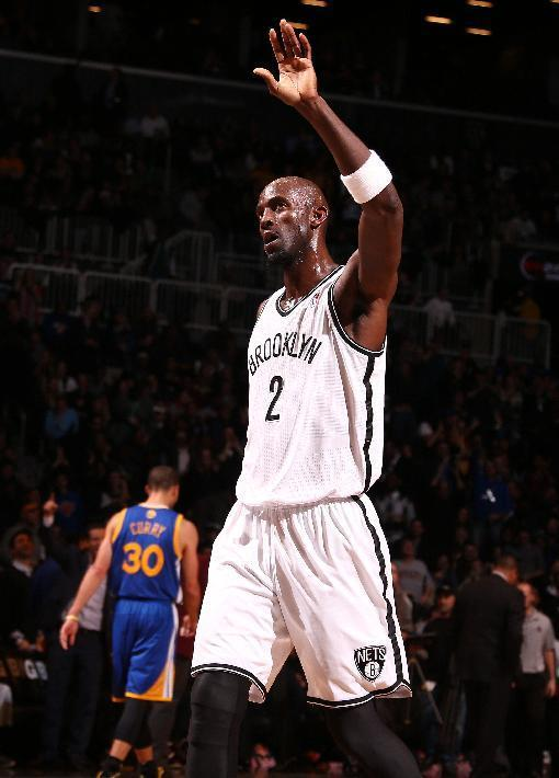 NEW YORK, NY - JANUARY 08: Kevin Garnett #2 of the Brooklyn Nets reacts during a game at the Barclays Center on January 8, 2014 in the Brooklyn borough of New York City. (Photo by Nathaniel S. Butler/NBAE via Getty Images)