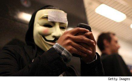 virtual whistle-blowers, man in Guy Fawkes mask