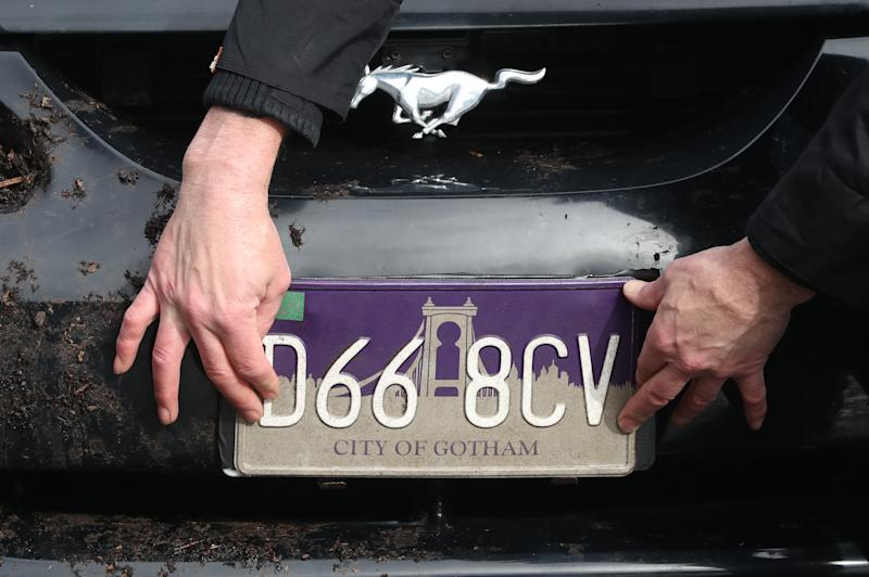 A City of Gotham number plate is fitted on a car during filming in Glasgow for a new movie for the Batman superhero franchise. (Photo by Andrew Milligan/PA Images via Getty Images)