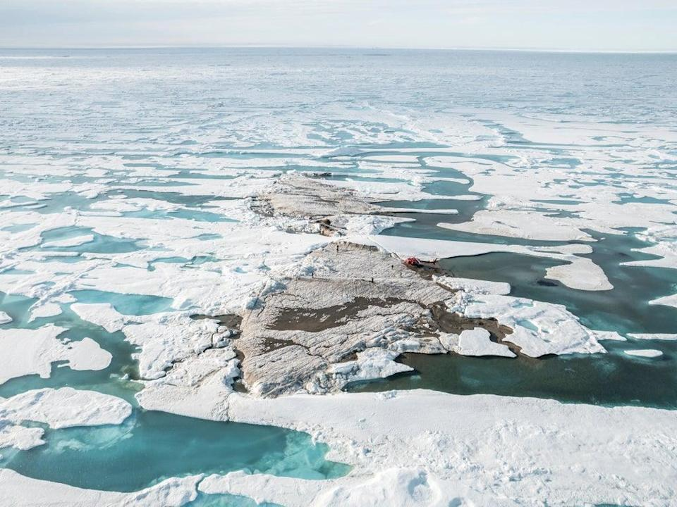 The tiny island off the coast of Greenland, discovered during the Leister Expedition (Julian Charriere/via REUTERS)